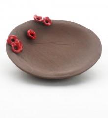 Repose-sachet de thé fleurs de cerisier japonais en faïence brune.