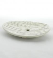 Porte-savon relief écorce d'arbre. Forme ovale.